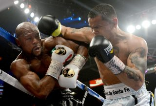Mayweather vs. Maidana - photo by NAOKI FUKUDA - Let's get one thing straight about last night's main event at the MGM Grand. Burt Clements, who scored 117-111 in favor of Mayweather, should be expelled from the sport. As Paulie Malignaggi pointed out in his post-fight comments, Clements must have been watching the fight unspool from a seat in the rafters.