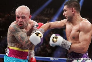Khan vs. Collazo - British star Amir Khan floored Luis Collazo three times en route to a 12-round unanimous decision 117-106, 119-104, 119-104.