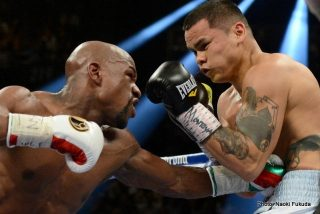 """Mayweather vs. Maidana - Marcos Rene """"El Chino"""" Maidana might not have been the best opponent Floyd """"Money"""" Mayweather, Jr. has ever faced, but he certainly proved to be his toughest.   Often times that is said about Maidana.   His awkward style turns fights into armed conflicts.   He throws buzz bombs, rockets, and mortar shots.  His overhand right is the most fun to watch.   It should be called an overhead right, because It resembles a mortar round.   It travels high up and over, and then bombs away as it decends.  If Money or TBE, as he now prefers, would have pulled back from that punch saturday night at the MGM Grand, there would have been an explosion, and his first defeat might have resulted.   Instead, TBE intelligently stayed inside the punch, so at worst it would carom off the back of his dome or just whiz by."""