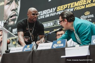 """Floyd Mayweather Jr, Marcos Maidana - NEW YORK (July 14, 2014) – Eleven-time world champion Floyd """"Money"""" Mayweather and former welterweight titlist Marcos """"El Chino"""" Maidana held an announcement press conference in Times Square on Monday to formally announce their highly anticipated rematch taking place Saturday, Sept. 13 at MGM Grand in Las Vegas, live on SHOWTIME PPV®."""