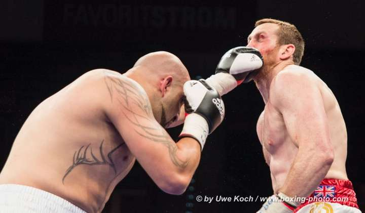 David Price, Erkan Teper -  photos: www.boxing-photo.com - Uwe Koch -- European heavyweight champion Erkan Teper, now 15-0 (10KO's), and his ferocious left hand dispatched David Price, 19-3 (16KO's), in sickening fashion tonight, leaving the career of the British heavyweight's career in tatters.