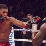 "Anthony Joshua, Evander Holyfield - It's one of the most famous and revered set of numbers in the sport of boxing: heavyweight immortal Rocky Marciano's 49-0 record. Ever since ""The Rock"" said goodbye to the ring with his perfect ledger, have heavyweights tried to break the record the hugely popular fighter (hugely popular in both life and in death) left behind. Larry Holmes came closest, in 1985, when he defeated Carl Williams to extends his record to 48-0. A controversial and very bitter (for Holmes) loss to Michael Spinks in a heavily hyped fight that same year ruined Larry's aims to tie with Marciano's magical numbers."