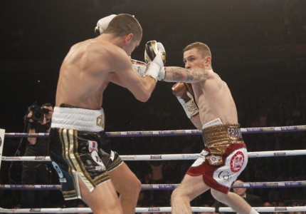 Frampton decisions Quigg, wins WBA title