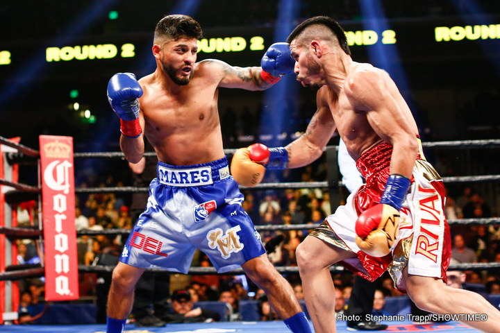 Abner Mares, Jesus Cuellar - Abner Mares, the new WBA Featherweight World Championship boxer (30-2-1, 15 KOs), and Robert Garcia, Boxing trainer who has coached 10 World Champion boxers, celebrate an electric and impressive upset with Mares' 12-round split decision over defending champion Jesus Cuellar (28-2, 21 KOs) in Los Angeles this past Saturday. The fight was the main event of a SHOWTIME CHAMPIONSHIP BOXING doubleheader.