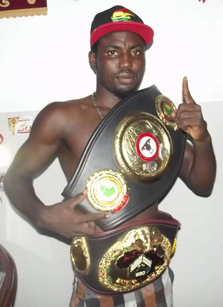 Rafael Mensah - The highly anticipated ring battle between Ghana's WBA number 3 rated super featherweight, Rafael Mensah and Fatiou Fassinou of Benin in the UK has been rescheduled to Friday March 24, a week later than the earlier announced March 18.