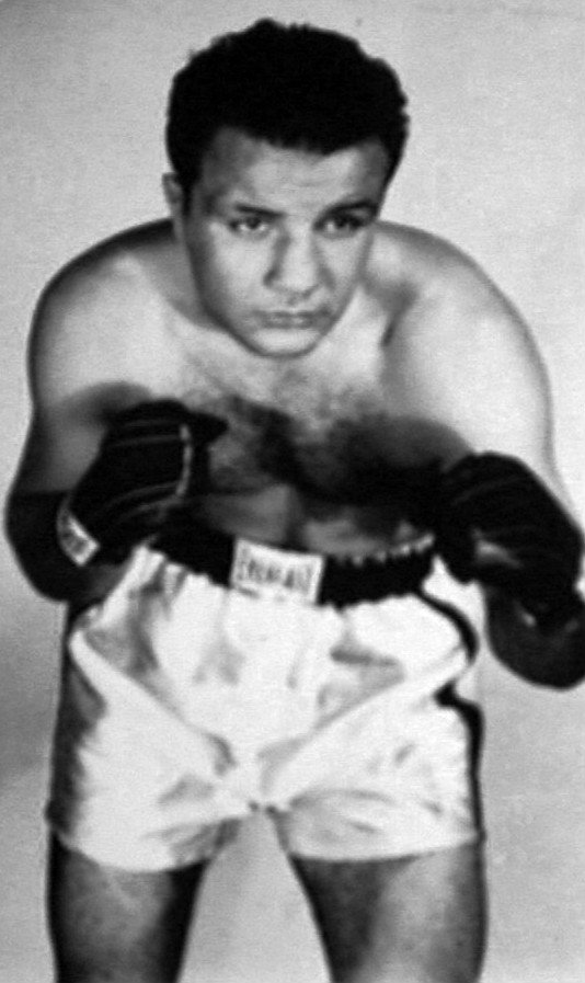 Boxing History - 65 years ago on New Year's Eve of all nights for a prize fight, light-heavyweight contender Danny Nardico accomplished something that no other man had done at the time, and no other man ever would: the 25 year old knocked down and stopped the seemingly unstoppable Jake LaMotta. Nardico, who was sporting a hard-earned 42-8-4 pro ledger, faced a fading but still tough LaMotta, 81-17-14, in what would be one of the former middleweight king's final fights.