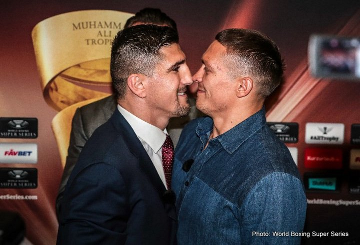 Aleksandr Usyk, Marco Huck - Things got heated at the final press conference with WBO World Champion Aleksandr Usyk and Marco Huck before their Ali Trophy quarter-final on Saturday at the Max-Schmeling-Halle in Berlin, Germany. During the classic head to head photo after the press conference, Huck pushed his Ukrainian opponent who managed to stay calm.