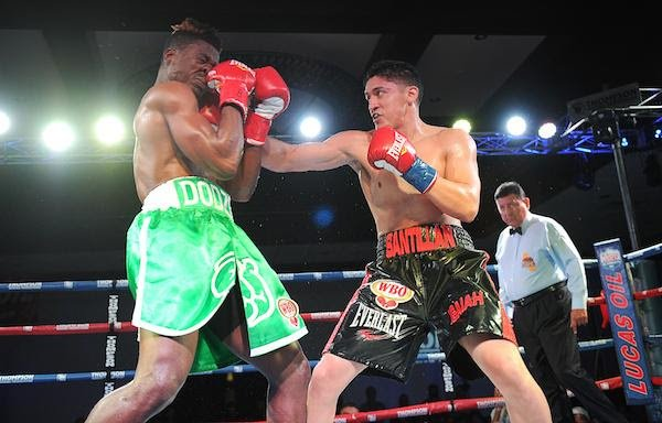 "Giovani Santillan - Giovani Santillan (23-0, 13 KOs), the No. 7 rated welterweight by the WBO, delivered a masterful performance in knocking out Dodzi Kemeh (13-2, 12 KOs) in the fourth round Friday night in Thompson Boxing Promotions' ""New Blood"" main event."