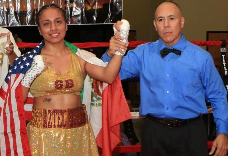 "Selina Barrios - Last night in star fashion, San Antonio's undefeated female boxing sensation, Selina ""Aztec Queen"" Barrios,"" improved to (4-0, 2 KOs), with devastating one punch knockout over current WBF international lightweight champion, Aida ""Lady Sparta"" Satybaldinova (3-1-1).  Barrios landed a crushing picture perfect left hook to the chin of Satybaldinova, ending the bout at the 1:24 mark of round four, in what many would say is a candidate for ""Knockout of the Year"". The fight that took place at the American Bank Center Water Garden room in Corpus Christi, TX, presented by Reyna Promotions."