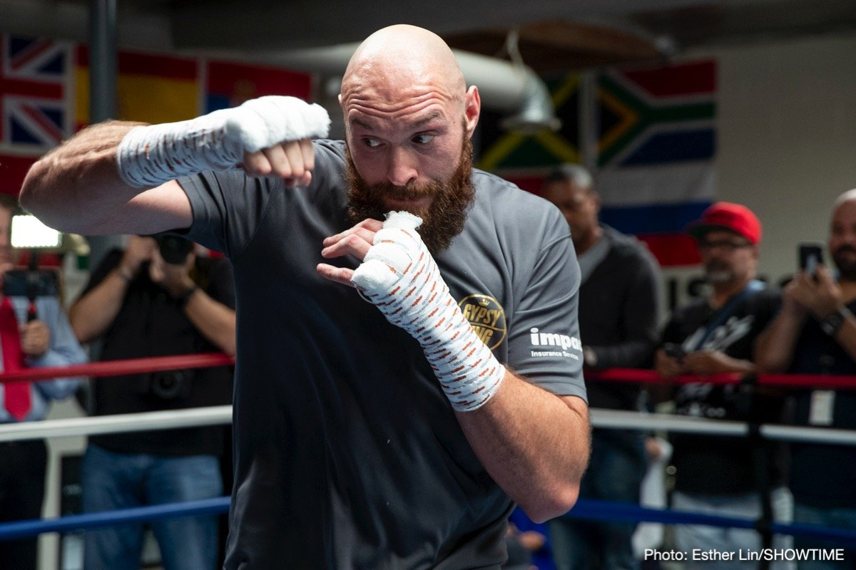 """Tyson Fury - The physical transformation undergone by Tyson Fury over the last six months or so has been amazing to see. Right now, with the lineal heavyweight champ a week away from his massive, must-win fight with WBC king Deontay Wilder, Fury has released some photos of him in the gym, and they are startling to see. Fury, a giant of a man at over 6'8,"""" looks comparatively skinny next to his old self."""