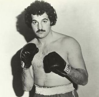 New England heavyweight John Dino Denis fought a number of great fighters during his 13-year pro career, including George Foreman and Gerry Cooney - Denis lost the big ones yet he always gave his all in each fight - Retiring in 1990 with a 45-5-2(20) record (as per BoxRec; John says he had 49 wins) the former heavyweight contender says today, candidly, that he fought for money, not for glory.