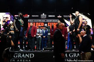Charles Martin - Tyson Fury (29-0-1, 20 KOs) kept his word in weighing in over 270 lbs on Friday at his weigh-in for his rematch with WBC heavyweight champion Deontay Wilder. Fury weighed in at 273 lbs with his shirt on. Wilder (42-0-1, 41 KOs) weighed in at 231 lbs. The two didn't have a face-off, as it was banned by the Nevada Commission because of the shoving the two fighters did last Wednesday when they faced off at the final press conference.