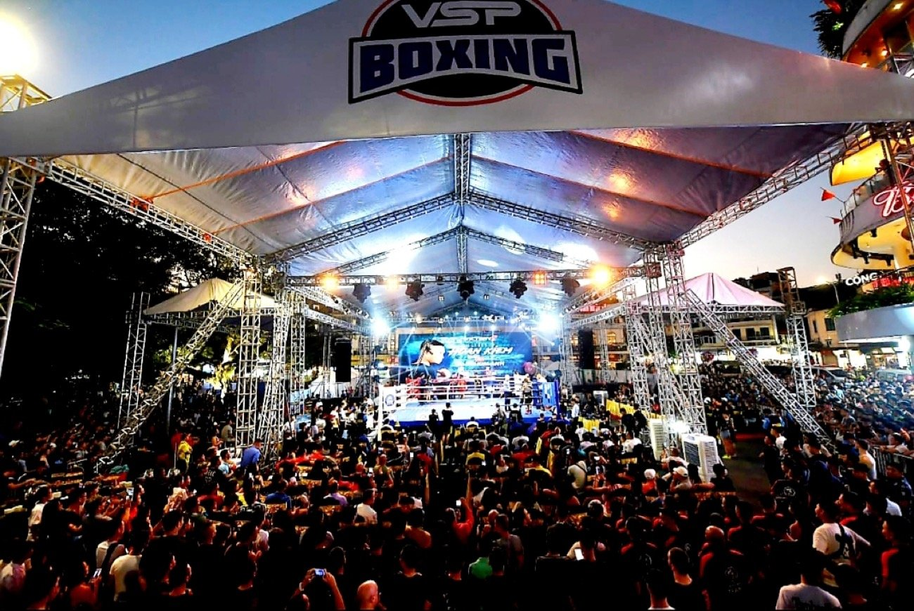 """- Boxing event organizers Victory 8 produced a Facebook post today entitled """"This is Vietnam boxing!"""" The post showed crowd shots from their third and most recent event held in Hanoi. The pictures are telling and endorse their narrative. At an iconic outdoor location, pitched beside the mystical Lake of Hoan Kiem, sit 25,000 fiercely nationalistic Vietnamese with big smiles on their faces. They are watching boxing. Who knew Vietnamese could box?  Well till now, not many!"""
