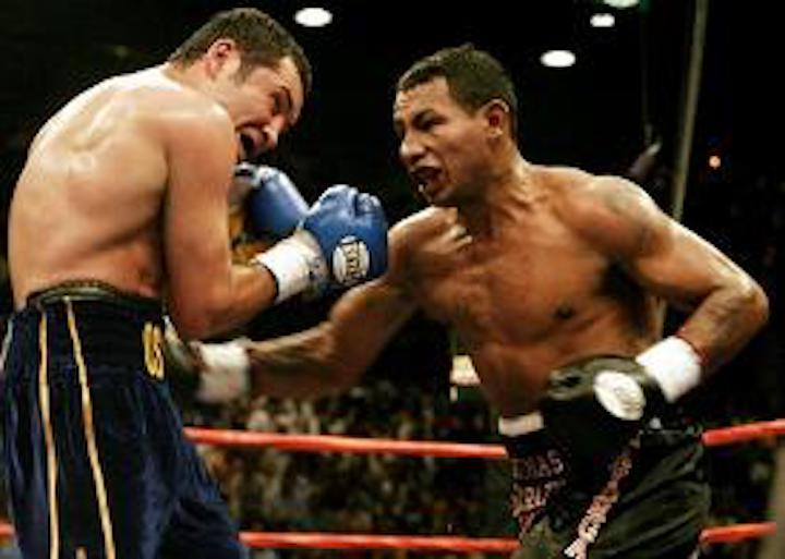 Oscar De La Hoya, Ricardo Mayorga - Mayorga had regrouped after losing his welterweight title to Cory Spinks; winning a version of the 154 pound title, this after losing to Felix Trinidad. Mayorga had beaten Michele Piccirillo to snatch the vacant WBC super-welter strap and now he wanted to cash-in in a super-fight with the biggest non-heavyweight star in boxing. And how Mayorga enjoyed himself in the long build-up to the fight. Working himself and others into a frenzy, Mayorga was uncontrollable.