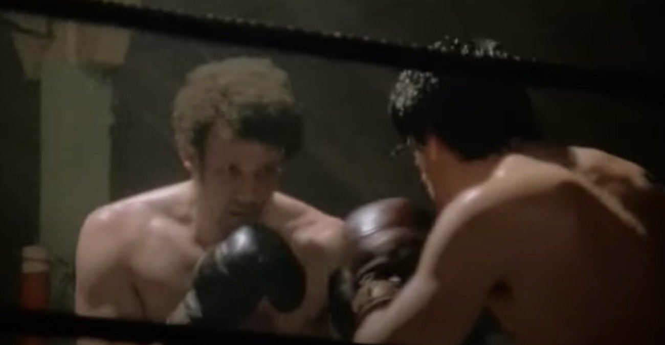 """Pedro Lovell - Seen brawling with fellow """"ham 'n' egger,"""" the fictitious Rocky Balboa in the opening scene of the 1976 oscar-winning classic, is real life boxer Pedro Lovell – AKA Spider Rico. After landing the ultimate cheap shot head-butt on a badly fatigued Balboa, Spider gets taken out, the nasty butt reawakening the fighting spirit in Rocky."""