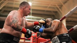 """Justin Rolfe, Larry Smith - Two regional title bouts, supported by several stay-busy fights, highlighted Granite Chin Promotion's first pro boxing event since this past November, 'Return to Derry,"""" last night (Sat., Aug. 29), in front of a near-capacity crowd at New England Sports Center in Derry, New Hampshire."""