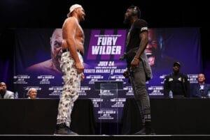 Tyson Fury taunts Deontay Wilder and trainer Malik Scott