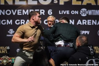 Caleb  Plant punches Canelo Alvarez in the jaw during face off