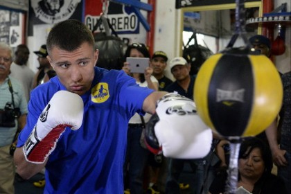 Vasyl Lomachenko and Garry Russell Jr. battle it out for the vacant WBO featherweight title