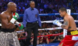 Mayweather vs. Maidana 2 - Marcos Maidana (35-5, 31 KOs) resorted to biting tonight but it still didn't help him against WBA/WBC welterweight champion Floyd Mayweather Jr (47-0, 26 KOs) who easily registered his 47th consecutive win on Saturday night at the MGM Grand in Las Vegas, Nevada. Maidana took Mayweather's left hand out of commission in the 8th round after allegedly biting Mayweather hard on his fingers of of his left hand while he had him in a headlock.