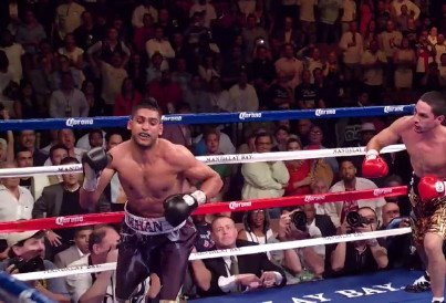 Amir Khan, Carlos Molina, Khan vs Molina, Virgil Hunter - By Michael Collins: Former IBF/WBA light welterweight champion Amir Khan is convinced that his new trainer Virgil Hunter can turn his sinking career around and bring it back to where it briefly was while Khan was being trained by the well respected Freddie Roach from 2009 to 2012. Khan started out well with Roach, winning his first six fights before things started to turn rotten for him with two losses to Lamont Peterson and Danny Garcia.