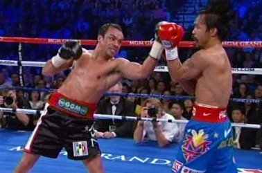 Manny Pacquiao - By Rob Smith: 33-year-old Manny Pacquiao (54-4-2, 38 KO's) is expected to sign to fight 39-year-old Juan Manuel Marquez (54-6-1, 39 KO's) on December 8th now that Marquez's only real competitor for the fight, Miguel Cotto, has decided on taking on Austin Trout on December 1st. Technically, WBO welterweight champion Tim Bradley is still in the running for Pacquiao's next fight on December 8th, but he's not a serious option because of the controversy that surrounded his win over Pacquiao last June. But importantly, Bradley isn't an option because the Pacquiao-Bradley fight brought in low pay per view totals last time out.
