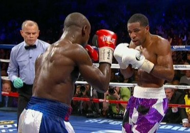 Peterson beats Jean by 12 round decision; Charlos decisions Rosado