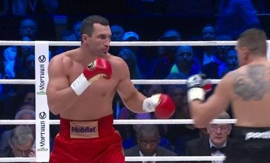 Klitschko vs. Wach - By Michael Collins: In a fight that was somewhat interesting to watch during portions of the action, IBF/IBO/WBA/WBO heavyweight champion Wladimir Klitschko (59-3, 50 KO's) defeated a way out of his depth Mariusz Wach (27-1, 15 KO's) by a 12 round unanimous decision tonight at the O2 World Arena in Hamburg, Germany. The only round you could possibly give to the 32-year-old Wach was the 5th when he landed a good hand to the head of Wladimir after backing him up agaisnt the ropes.